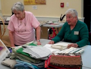 Volunteers do the sewing ~ We furnish the fabric